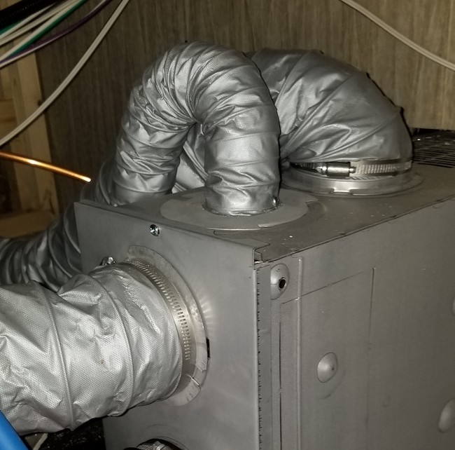 Suburban RV furnace showing restricted ducting. Top outlets are restricted with short radius turns