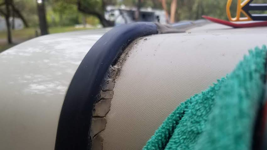 RV silicone caulk degraded and flaking on rubber roof after just two years