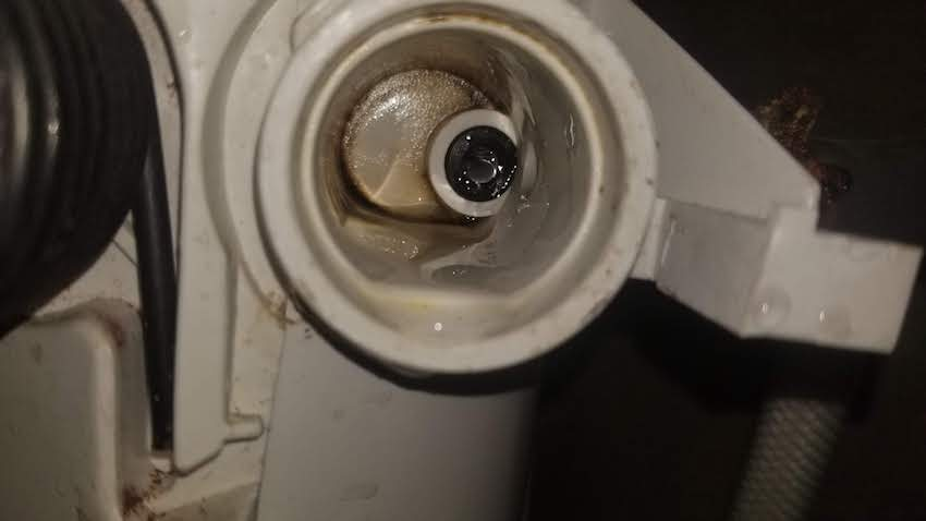 Image of worn RV toilet inlet valve. Rubber seal wears easily.